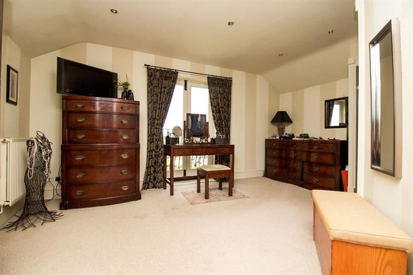 Dressing room to master bedroom